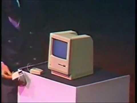 Steve Jobs presenting the first Mac in 1984