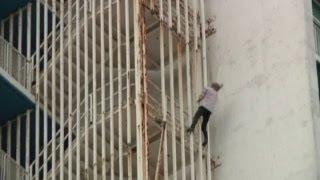 Fearless French 'Spiderman' Alain Robert scales rusty Havana tower block in Cuba