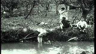 U.S.Army soldiers, of 7th Field Artillery, clean themselves in a stream in  Franc...HD Stock Footage