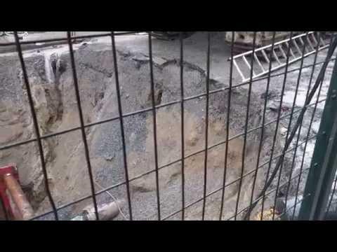 street erosion beneath digger