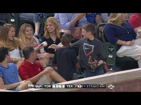 Young fan gives decoy ball to pretty lady