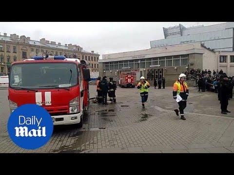Russia President Vladimir Putin lays flowers at scene of blast in St Petersburg - Daily Mail
