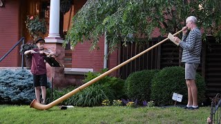 Watch now: Symphony Orchestra member puts on neighborhood alphorn concert