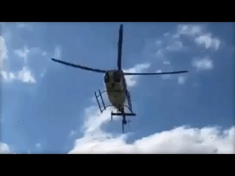 Helicopter flies close to Penn State tailgate, sending debris flying