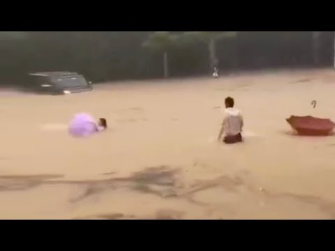 Strangers rescue woman and child from flood