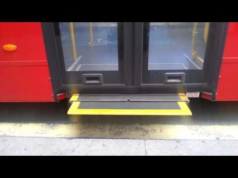 Electric ramp sliding out of a London bus