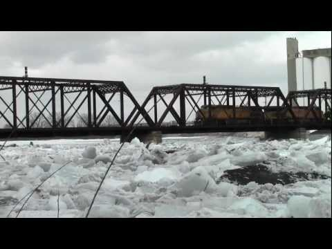 UP Mix Freight Crosses The Cedar River Railroad bridge Downtown Cedar Rapids,IA
