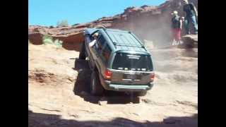 Jeep Grand Cherokee's climb the enterence of the Pickle (Moab, UT)