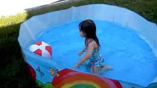 Madie in pool 2011