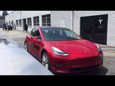 Red Tesla Model 3 at Los Angeles Service Center