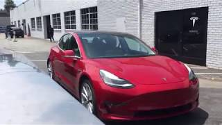 Red Tesla Model 3 at Los Angeles Service Center