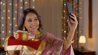 Beautiful Indian woman taking a selfie while waiting for her husband on the occasion of Karwa Chauth