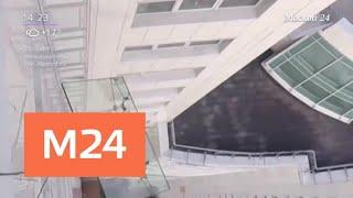 Падение 380-килограммового стекла с московской высотки снято на видео - Москва 24
