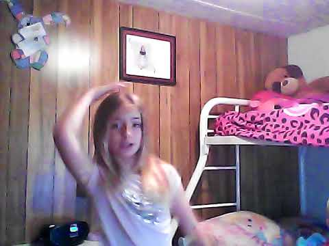 9 year old girl dancing to singing in the shower