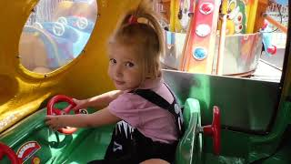 Alina and baby born on helicopter at outdoor playground amusement park