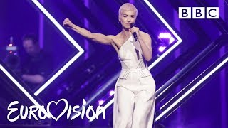 SuRie carries on after stage invasion -