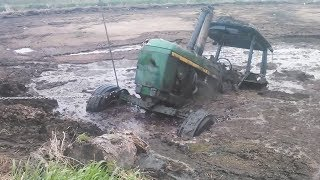 WHAT HAPPENS WHEN POWERFUL TRACTORS ARE STUCK IN DEEP MUD