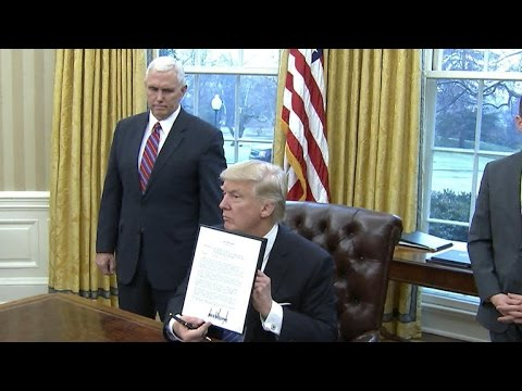 Watch: President Trump signs executive orders, including withdrawal from TPP