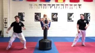 Brothers Practice Kicks on Dummy