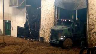 8x8 Heavy Equipment Transporter drives through mud bog