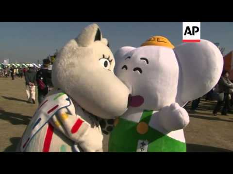 A leaping yellow pear is the star of Japan's international mascot festival