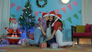 Christian mother gifting special Christmas presents to her children in Santa hats