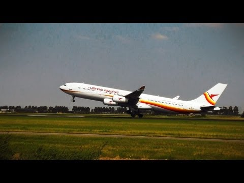 Surinam Airways A340-300 Land and Takeoff at Amsterdam Schip