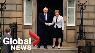 New UK PM Boris Johnson booed on visit with Scotland's Sturgeon
