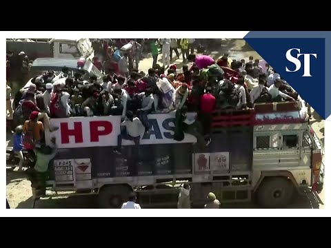 Migrant workers leave cities on trucks in locked down India