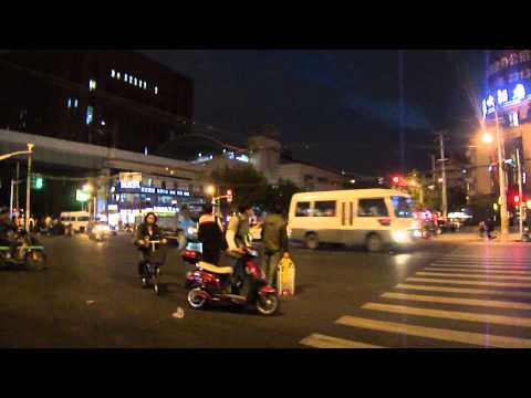 Crossing a busy Shanghai Street