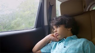 Tired little school kid traveling back home from long summer vacations in a car