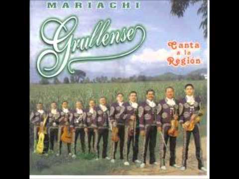 dos botellas de mezcal mariachi grullense