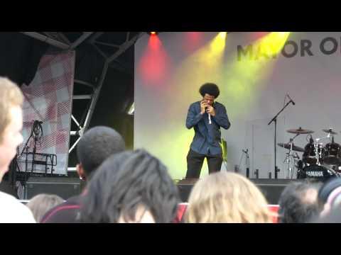 Philip Achille plays harmonica at Trafalgar Square