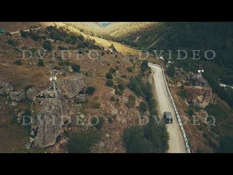 Drone view truck car driving along winding road mountain at sumer day