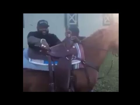 Rick Ross Attempts To Mount a Horse