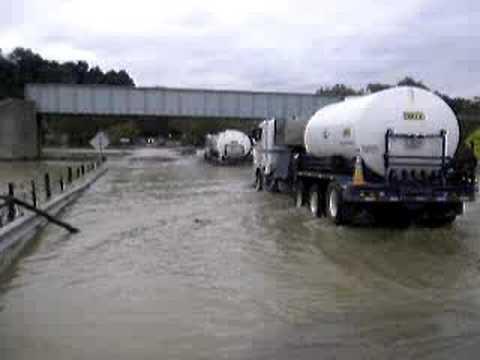 Rigs Pushing Through a Flood in Waynesburg, Pennsylvania