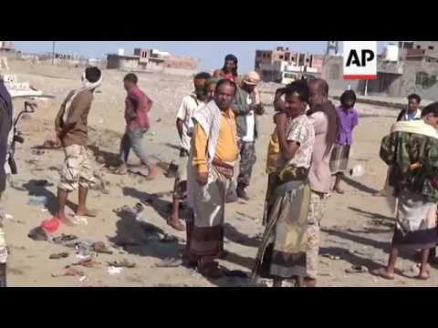 Bombing kills at least 30 outside Yemen military camp