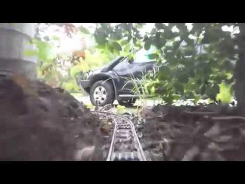 Железная дорога длиной 50 метров вокруг всего дома