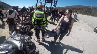 Crash! Rider lowsides into onlookers and bikes