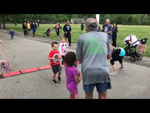 Frank Shorter hands out medals at children