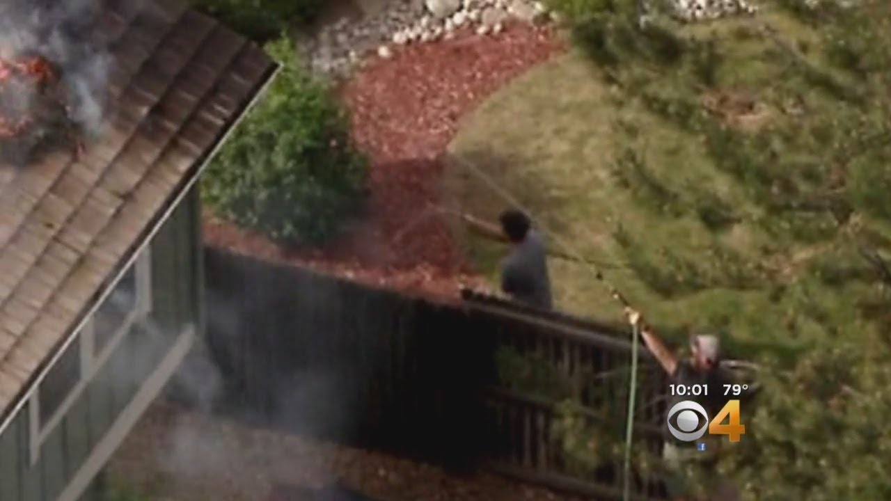 Neighbors Save Burning Home With Garden Hoses - YouTube