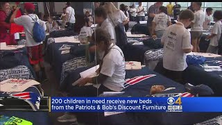 200 Children In Need Receive New Beds From Patriots, Bob's Discount Furniture
