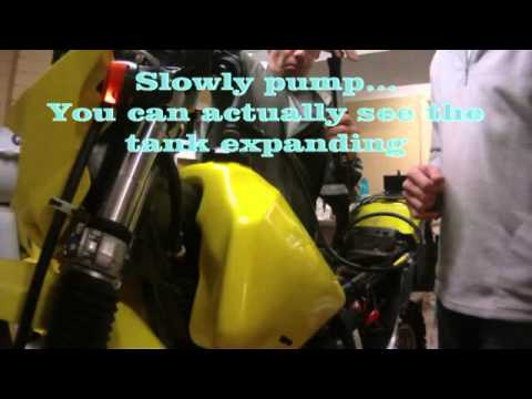 Expanding a motorcycles plastic fuel tank - YouTube