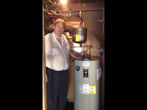 Electric water heater installed to save money in oil costs