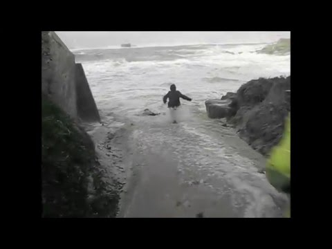 Elderly couple almost swept out to sea.