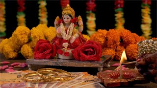 Diwali celebration - Indian women lighting diya for performing goddess Lakshmi puja