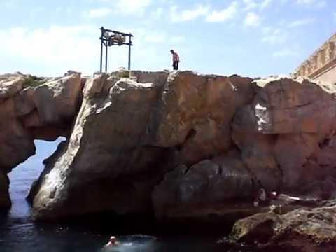 Jumping off rocks In Valletta, Malta