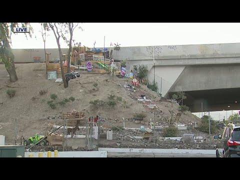 Download Homeless man creates mini mansion alongside Pacoima freeway