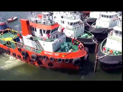 Loading of 16 Tugboats in Singapore  Part 1, from Brumby Shipholdings, filmed by Studio 8 Pte Lt