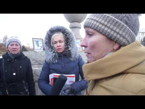 Участница пикета Россия против жестокости 2016 (Новосибирск) дает интервью телеканалу